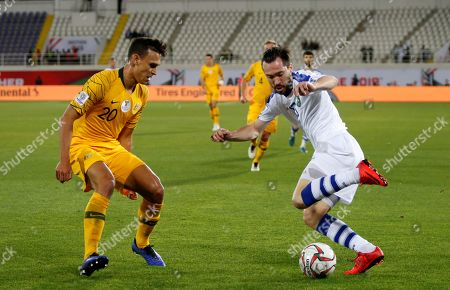 Oleg Zoteev (R) of Uzbekistan in action against Trent Sainsbury of Australia during the 2019 AFC Asian Cup round of 16 soccer match between Australia and Uzbekistan in Al Ain, United Arab Emirates, 21 January 2019.