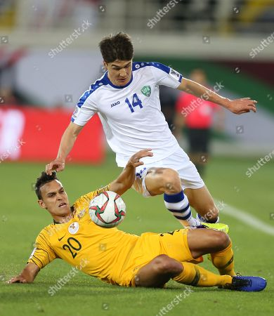 Trent Sainsbury (L) of Australia in action against Eldor Shomurodov of Uzbekistan during the 2019 AFC Asian Cup round of 16 soccer match between Australia and Uzbekistan in Al Ain, United Arab Emirates, 21 January 2019.