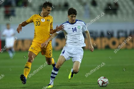 Stock Picture of Australia's defender Trent Sainsbury, left, fights for the ball with Uzbekistan's forward Eldor Shomurodov during the AFC Asian Cup round of 16 soccer match between Australia and Uzbekistan at the Khalifa bin Zayed Stadium in Al Ain, United Arab Emirates
