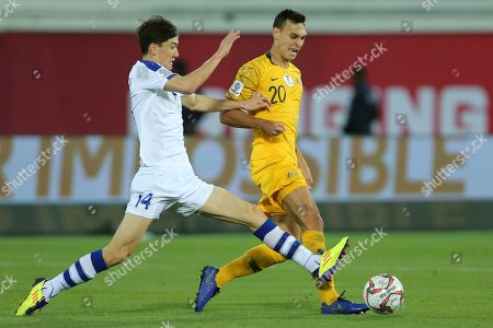 Australia's defender Trent Sainsbury, right, fights for the ball with Uzbekistan's forward Eldor Shomurodov during the AFC Asian Cup round of 16 soccer match between Australia and Uzbekistan at the Khalifa bin Zayed Stadium in Al Ain, United Arab Emirates