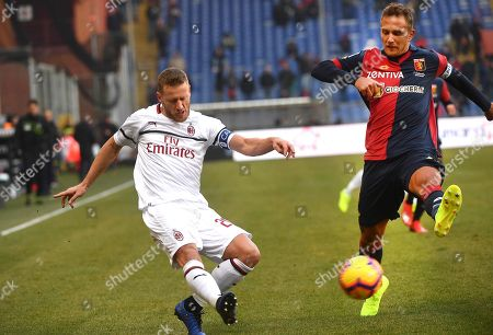 Genoa's Domenico Criscito (R) and Milan's Ignazio Abate (R) in action during the Italian Serie A soccer match between Genoa CFC and AC Milan at Luigi Ferraris stadium in Genoa, Italy, 21 January 2019.