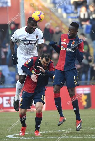 Genoa's Goran Pandev (C) and Milan's Cristian Zapata (L) in action during the Italian Serie A soccer match between Genoa CFC and AC Milan at Luigi Ferraris stadium in Genoa, Italy, 21 January 2019.
