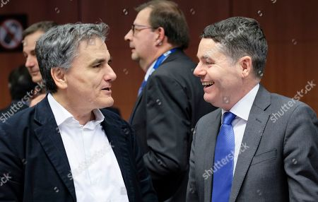 Greek Finance Minister Euclid Tsakalotos and Irish Minister for Finance and Public Expenditure Paschal Donohoe (R) during Eurogroup Finance Ministers' meeting in Brussels, Belgium, 21 January 2019.