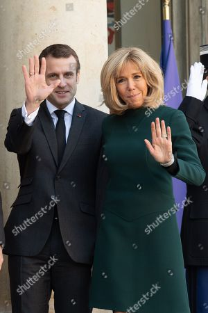 French President Emmanuel Macron and his wife Brigitte Trogneux at the Elysee Palace in Paris.