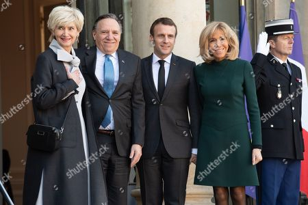French President Emmanuel Macron and his wife Brigitte Trogneux welcome Quebec Prime Minister Francois Legault and his wife Isabelle Brais as they arrive for a meeting at the Elysee Palace in Paris.