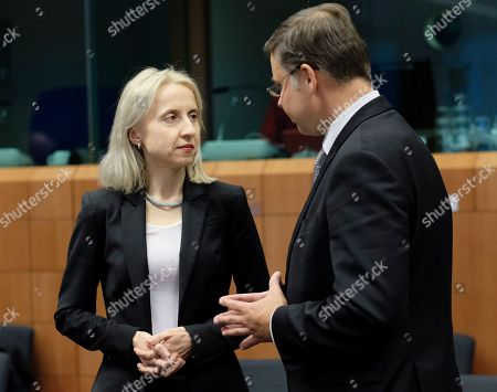 Polish Minister of Finance Teresa Czerwinska chats with EU Commission Vice-President Valdis Dombrovskis during Eurogroup Finance Ministers' meeting in Brussels, Belgium, 21 January 2019.