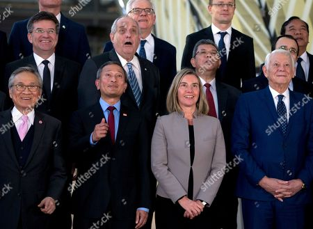 Romanian Foreign Minister Teodor-Viorel Melescanu, front right, poses with from front left, Thailand's Foreign Minister Don Pramudwinai, Singapore's Foreign Minister Vivian Balakrishnan and European Union foreign policy chief Federica Mogherini during a group photo at an EU ASEAN meeting at the Europa building in Brussels