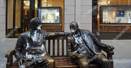 Pedestrians walk past 'The Allies' sculpture depicting Franklin D Roosevelt and Winston Churchill, which has been vandalised with white paint in London, Britain, 21 January 2019.