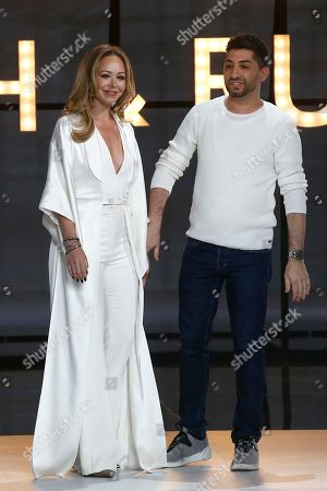 Tamara Ralph, Michael Russo. Designers Tamara Ralph, left, and Michael Russo accept applause at the end of the Ralph & Russo Spring/Summer 2019 Haute Couture fashion collection presented in Paris