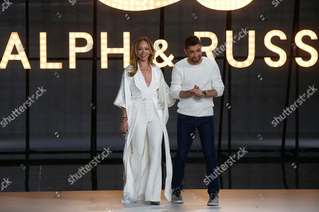 Stock Photo of Tamara Ralph, Michael Russo. Designers Tamara Ralph, left, and Michael Russo accept applause at the end of the Ralph & Russo Spring/Summer 2019 Haute Couture fashion collection presented in Paris
