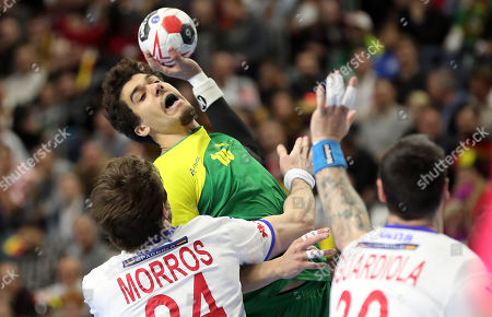 Viran Morros de Argila (L) and Gedeon Guardiola Vilaplana (R) of Spain in action against Jose Toledo (L) of Brazil during the main round group one match between Spain and Brazil at the IHF Men's Handball World Championship in Cologne, Germany, 21 January 2019.