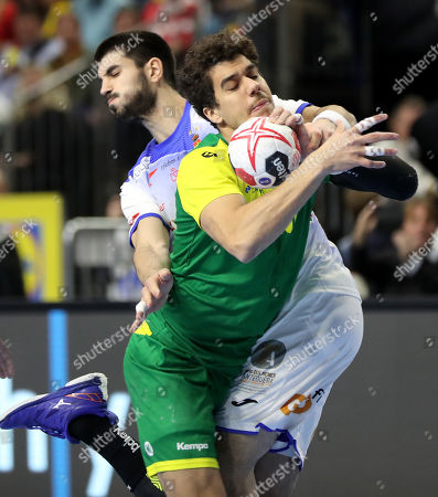 Eduardo Gurbindo Martinez (L) of Spain in action against Jose Toledo (R) of Brazil during the main round group one match between Spain and Brazil at the IHF Men's Handball World Championship in Cologne, Germany, 21 January 2019.