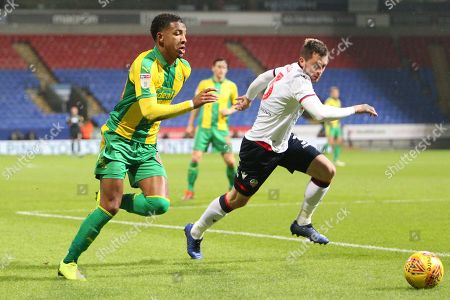 Bolton Wanderers defender Andrew Taylor (3) and 	West Bromwich Albion midfielder Mason Holgate (68)during the EFL Sky Bet Championship match between Bolton Wanderers and West Bromwich Albion at The University of Bolton Stadium, Bolton