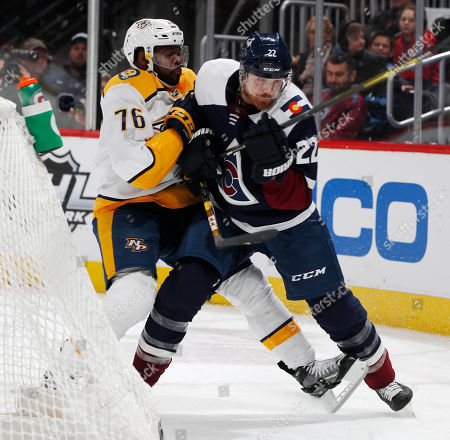 P K Subban, Colin Wilson, p k subban, colin wilson. Nashville Predators defenseman P.K. Subban, left, slows down Colorado Avalanche center Colin Wilson who pursues the puck in the third period of an NHL hockey game, in Denver
