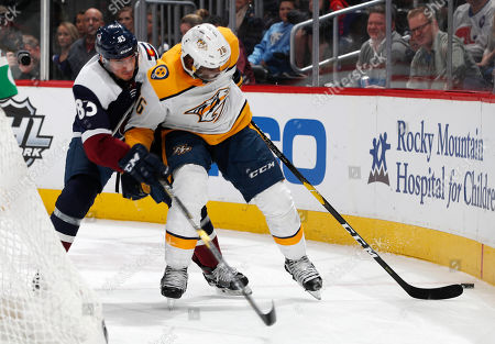 Matt Nieto, P K Subban, p k subban, matt nieto. Colorado Avalanche left wing Matt Nieto, left, fights for control of the puck with Nashville Predators defenseman P.K. Subban in the third period of an NHL hockey game, in Denver. The Predators won 4-1