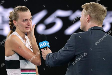 Petra Kvitova of the Czech Republic is interviewed by Jim Courier after defeating Australia's Ashleigh Barty in their quarterfinal match at the Australian Open tennis championships in Melbourne, Australia