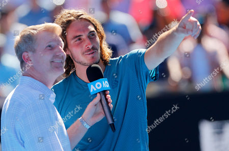 Stock Picture of Stefanos Tsitsipas of Greece celebrates following his win speaking to Jim Courier