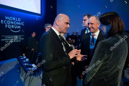 Swiss Federal Councillor Alain Berset (L) talks to Adrian Hasler, Head of the Government of Liechtenstein (C) prior to a plenary session in the Congress Hall on the first day of the 49th annual meeting of the World Economic Forum (WEF) in Davos, Switzerland, 22 January 2019. The meeting brings together entrepreneurs, scientists, corporate and political leaders in Davos under the topic 'Globalization 4.0' from 22 to 25 January 2019.