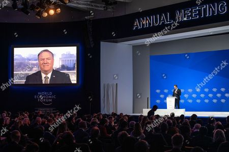 Michael Pompeo, US Secretary of State, speaks via video transmission, next to Borge Brende, president of the managing board WEF, during a plenary session in the Congress Hall of the 49th annual meeting of the World Economic Forum, WEF, in Davos, Switzerland, 22 January 2019. The meeting brings together entrepreneurs, scientists, corporate and political leaders in Davos under the topic 'Globalization 4.0' from 22 - 25 January 2019.