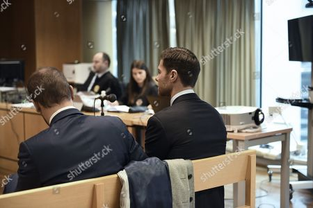 Former Real Madrid midfielder Xabi Alonso (R) attends his trial at a court in Madrid, Spain, 22 January 2019. Alonso is accused of three tax offenses.
