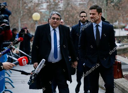 Former Real Madrid player Xabi Alonso, right, arrives at the court in Madrid on. He is accused of defrauding tax authorities of about two million euros (2.3 million US dollars) from 2010-12 again in relation to income from image rights