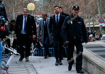 Former Real Madrid player Xabi Alonso, second right, arrives at the court in Madrid on. He is accused of defrauding tax authorities of about two million euros (2.3 million US dollars) from 2010-12 again in relation to income from image rights