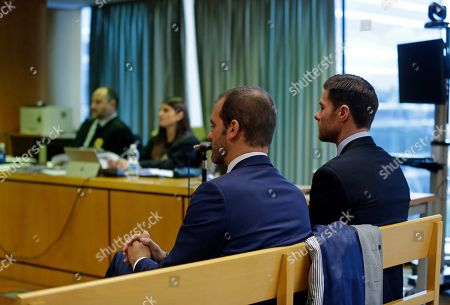 Former Real Madrid player Xabi Alonso, right, sits in the court in Madrid on . Alonso is accused of defrauding tax authorities of about two million euros (2.3 million US dollars) from 2010-12 again in relation to income from image rights