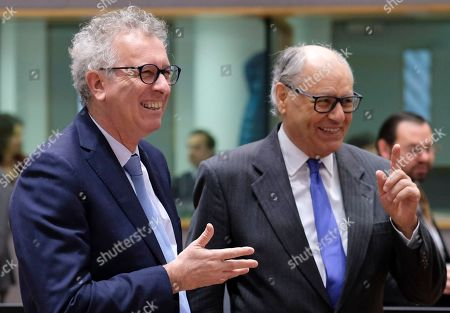 Luxembourg's Finance Minister Pierre Gramegna (L) and Malta Finance Minister Edward Scicluna talk during an European Finance Ministers' meeting in Brussels, Belgium, 22 January 2019.