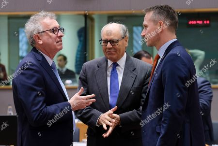 (L-R) Luxembourg's Finance Minister Pierre Gramegna, Malta's Finance Minister Edward Scicluna and Denmark's Finance Minister Kristian Jensen talk during an European Finance Ministers' meeting in Brussels, Belgium, 22 January 2019.
