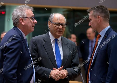 Malta's Finance Minister Edward Scicluna, center, speaks with Danish Finance Minister Kristian Jensen, right, and Luxembourg's Finance Minister Pierre Gramegna, left, during a meeting of EU finance ministers at the Europa building in Brussels