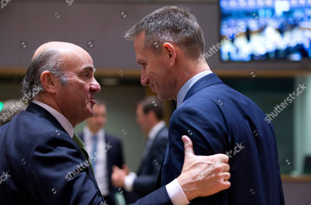 Vice-President of the European Central Bank Luis de Guindos, left, speaks with Danish Finance Minister Kristian Jensen during a meeting of EU finance ministers at the Europa building in Brussels