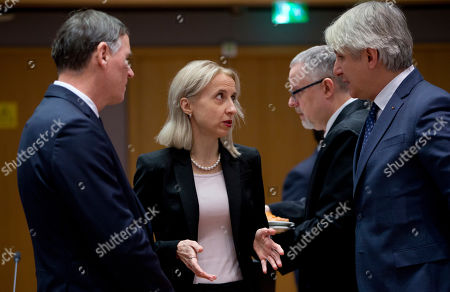Stock Photo of Slovenian Finance Minister Andrej Bertoncelj, left, speaks with Polish Minister of Finance Teresa Czerwinska, second left, and Romanian Finance Minister Eugene Teodorovici, right, during a meeting of EU finance ministers at the Europa building in Brussels