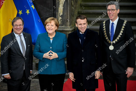 (L-R) Prime Minister of North Rhine-Westphalia Armin Laschet, German Chancellor Angela Merkel, French President Emmanuel Macron and the Lord Mayor of Aachen Marcel Philipp pose for a photo as they arrive for the signing of a new Franco-German friendship treaty in Aachen, Germany, 22 January 2019. President Macron and Chancellor Merkel will sign a new friendship treaty, intended to supplement the 1963 Elysee Treaty, pledging to provide deeper economic and defense ties and commitment to the EU.