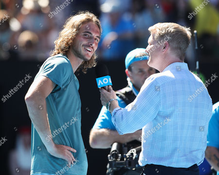 Stock Photo of Stefanos Tsitsipas interview with TV Moderator Jim Courier