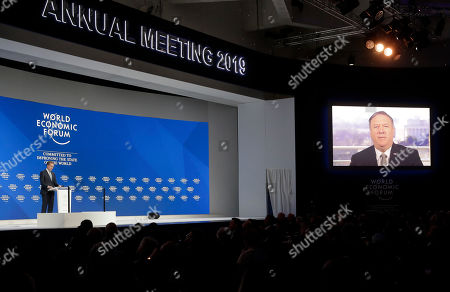 The President of the World Economic Forum Borge Brende stands on the stage as United States Secretary of State Mike Pompeo speaks through live video conference at the annual meeting of the World Economic Forum in Davos, Switzerland