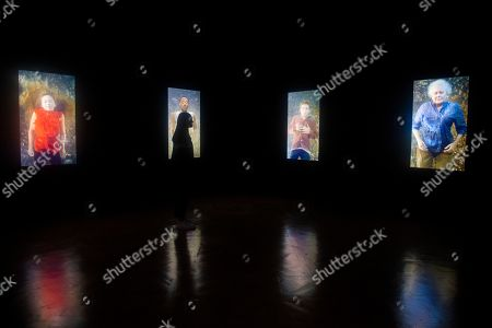 A gallery employee poses next to a video art installation by US artist Bill Viola, entitled 'The Dreamers,' during the press day for the exhibition 'Bill Viola / Michelangelo: Life and Rebirth' at the Royal Academy of Arts in London, Britain, 22 January 2019. The exhibit will open to the public from 26 January to 31 March 2019.