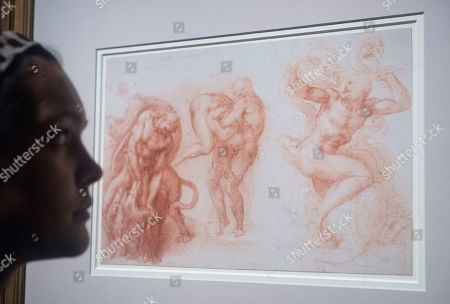 A gallery employee poses to a drawing by Italian Renaissance artist Michelangelo Buonarroti, entitled 'Three Labours of Hercules,' during the press day for the exhibition 'Bill Viola / Michelangelo: Life and Rebirth' at the Royal Academy of Arts in London, Britain, 22 January 2019. The exhibit will open to the public from 26 January to 31 March 2019.