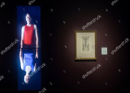 A video art installation (L) by US artist Bill Viola is on display next to a drawing (R) by Italian master Michelangelo Buanorrroti, entitled 'Christ on the Cross with the Virgin and St. John,' during the press day for the exhibition 'Bill Viola / Michelangelo: Life and Rebirth' at the Royal Academy of Arts in London, Britain, 22 January 2019. The exhibit will open to the public from 26 January to 31 March 2019.