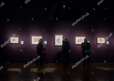 Visitors look to drawings by Italian Renaissance artist Michelangelo Buonarroti during the press day for the exhibition 'Bill Viola / Michelangelo: Life and Rebirth' at the Royal Academy of Arts in London, Britain, 22 January 2019. The exhibit will open to the public from 26 January to 31 March 2019.