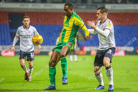 West Bromwich Albion's Rekeem Harper and Bolton Wanderers' Andrew Taylor compete for possession