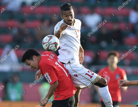 Bahrain's forward Mohamed Al Rohaini jumps fro the ball over South Korea's defender Kim Young-Gwon during the AFC Asian Cup round of 16 soccer match between South Korea and Bahrain at the Rashid Stadium in Dubai, United Arab Emirates