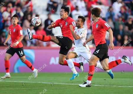South Korea's defender Kim Young-Gwon clears the ball in front of Bahrain's midfielder Jamal Rashed during the AFC Asian Cup round of 16 soccer match between South Korea and Bahrain at the Rashid Stadium in Dubai, United Arab Emirates