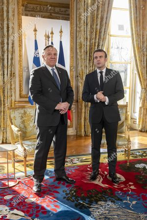 Stock Image of French President Emmanuel Macron greets Quebec Premier Francois Legault at the Elysee Palace, Paris.