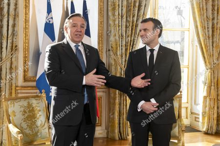 Stock Photo of French President Emmanuel Macron greets Quebec Premier Francois Legault at the Elysee Palace, Paris.