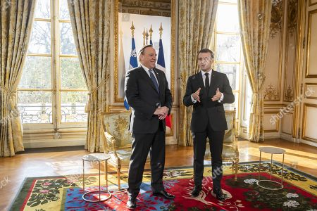 Stock Picture of French President Emmanuel Macron greets Quebec Premier Francois Legault at the Elysee Palace, Paris.