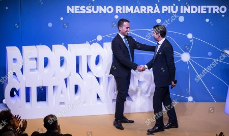 Italian Deputy Premier and Minister of Labor and Economic Development Luigi Di Maio (L) with Italian Prime Minister Giuseppe Conte (R) shake hands during an event of Five Star Movement in Rome, Italy, 22 January 2019. Italian Government has decided to nominate Lino Banfi representative of Italian UNESCO commission.