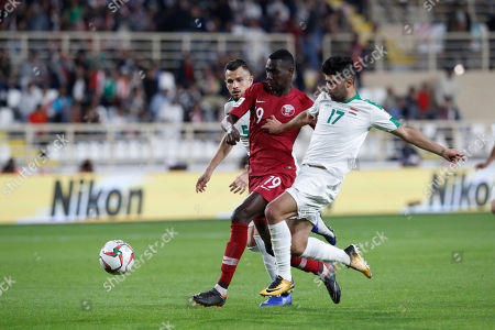 Qatar's forward Almoez Ali, centre, fights for the ball with Qatar's midfielder Ahmed Fathi, left, and Qatar's midfielder Abdelrahman Fahmi during the AFC Asian Cup round of 16 soccer match between Qatar and Iraq at Al Nahyan Stadium in Abu Dhabi, United Arab Emirates
