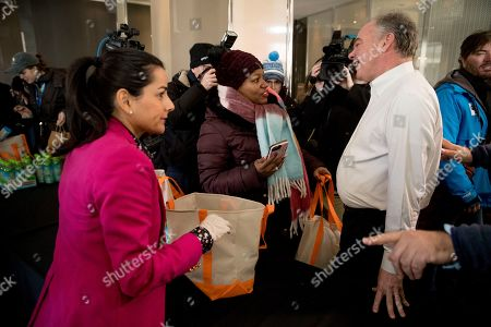 Tim Kaine, Nanette Barragan. Rep. Nanette Barragan, D-Calif., left, gives out bags of food and supplies to furloughed government workers as Sen. Tim Kaine, D-Va., right, gets a tour of at World Central Kitchen, the not-for-profit organization started by Chef Jose Andres, in Washington. The organization devoted to providing meals in the wake of natural disasters, has set up a distribution center just blocks from the U.S. Capitol building to assist those affected by the government shutdown