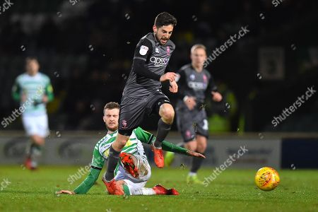 Tom Pett (7) of Lincoln City is fouled by Tom James (23) of Yeovil Town during the EFL Sky Bet League 2 match between Yeovil Town and Lincoln City at Huish Park, Yeovil