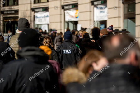 Stock Photo of Shane Smith, a TSA agent, waits with other furloughed government workers affected by the shutdown, in line for free food and supplies at World Central Kitchen, the not-for-profit organization started by Chef Jose Andres, in Washington. The organization devoted to providing meals in the wake of natural disasters, has set up a distribution center just blocks from the U.S. Capitol building to assist those affected by the government shutdown